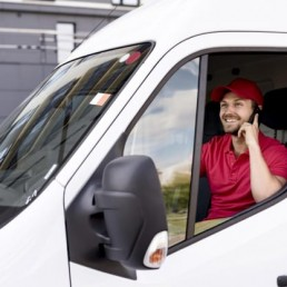 high-angle-delivery-service-man-talking-phone
